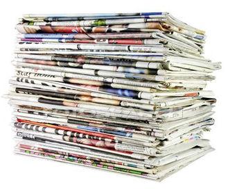 jornais em pilha